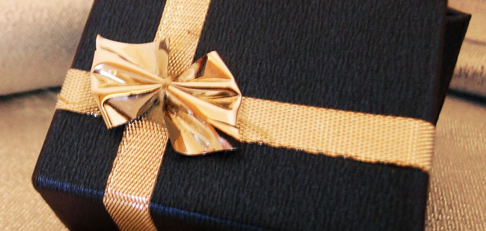 pretty wedding gift with gold ribbon